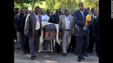 Elders carry Mandela's casket draped in a lion skin